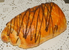 Picture of a baked pain au chocolat using croissant dough